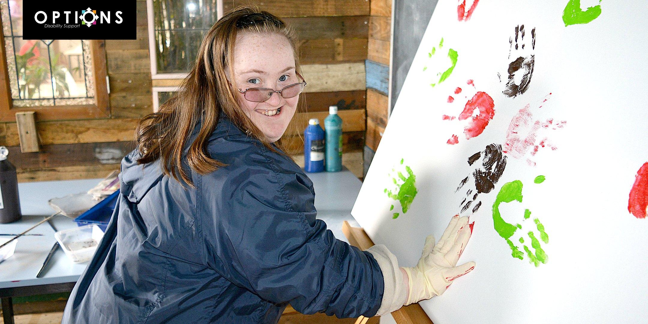 happy lady doing handprint artwork