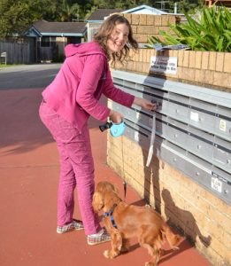 lady and her dog collecting her mail at supported living