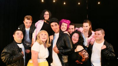 cast of the performance GREASE in costume